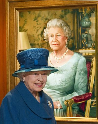 Queen Elizabeth II passes a portrait of herself as she tours the ocean liner \'Queen Elizabeth\' in 2010.