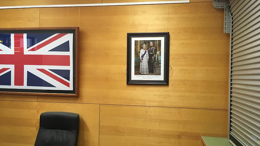 Framed photo of Queen Elizabeth II and Prince Philip, in community centre i