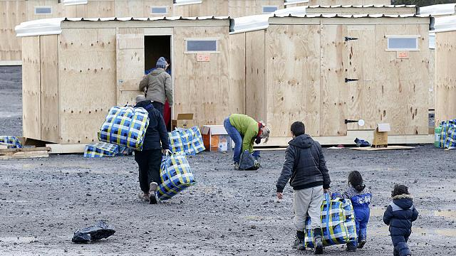France opens new refugee camp, amid protest