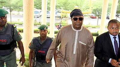 Former Nigerian defence chief remanded by court over corruption allegations