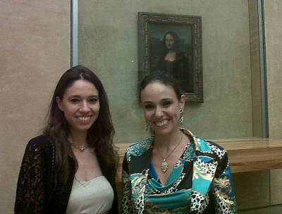 Sisters Natalia and Irina Strozzi pose next to the Mona Lisa at the Louvre in Paris.