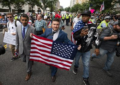 """Jason Kessler, center, and members of the alt-right march to the White House on the anniversary of """"Unite the Right"""" in Washington on Aug. 12, 2018."""