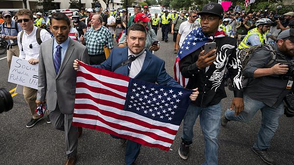 Image: Jason Kessler, center, and members of the alt-right march to the Whi