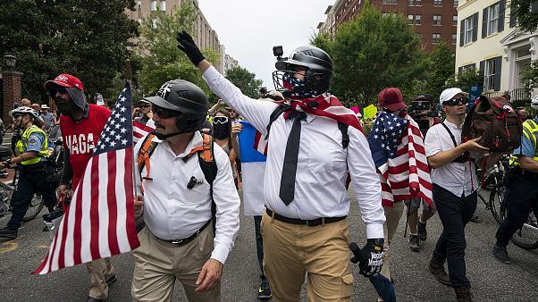 Image: White supremacists march on anniversary of Unite the Right rally in
