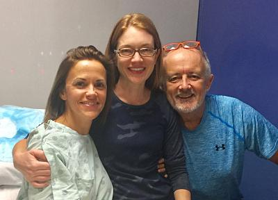 Neil and Lisa Emmott were humbled when Britani Atkinson, pictured with the Emmotts before her surgery, volunteered to donate a kidney so Neil could receive one. Atkinson\'s living kidney donation to a compatible stranger on the National Kidney Register kicked off a chain that resulted in four people receiving kidney transplants.