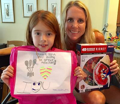 "The Emmotts\' daughter, Mackenzie, with her first grade teacher, Allison Malouf. Malouf volunteered to donate her kidney to help save Neil Emmott\'s life. ""When you are a teacher, you feel like a part of these children's lives.Their daughter was like a child of my own,"" she said."