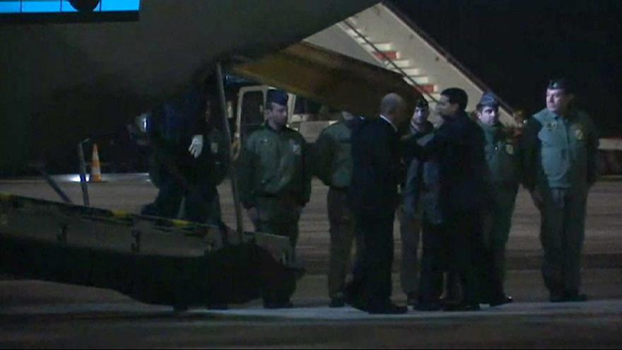 The remains of two Italian hostages are flown back to Rome