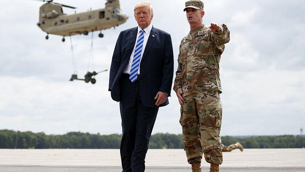 Trump snubs McCain at Fort Drum