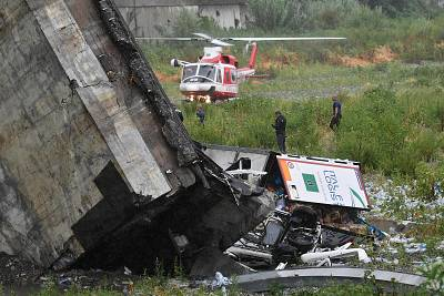 Rescuers scour the debris after the bridge collapsed.