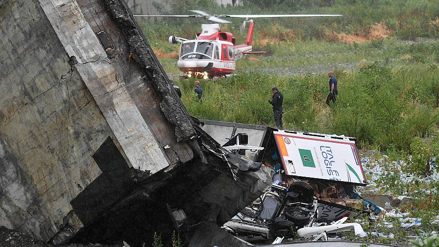 Image: Rescuers scour the debris after the bridge collapsed