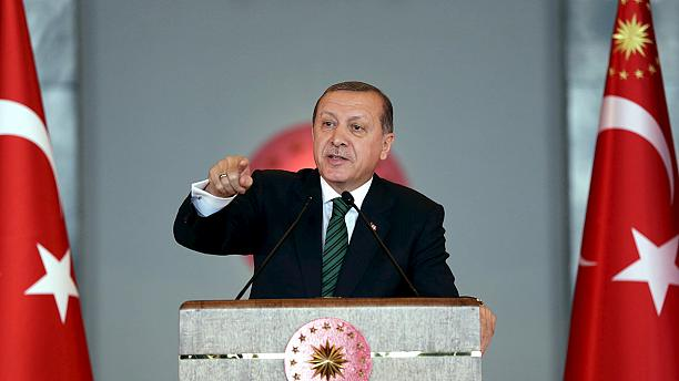 Erdogan warns Turkey's top courts over freed journalists