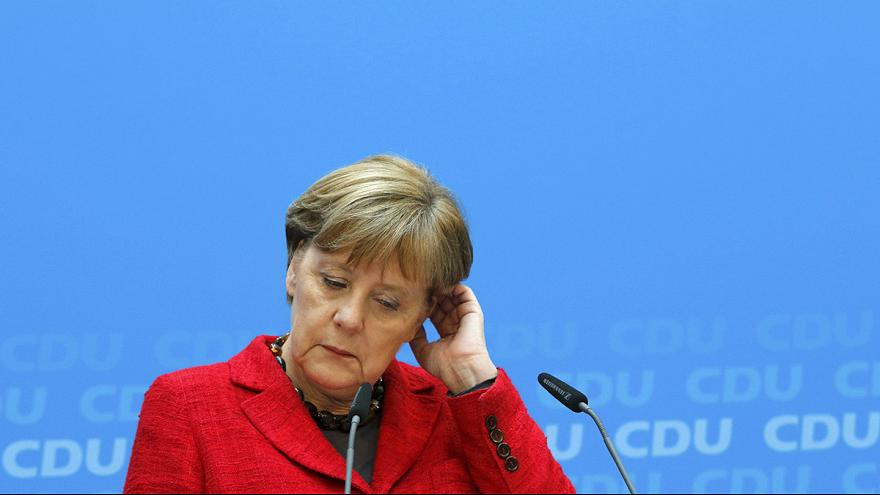Merkel comes under pressure to change her migrant policy