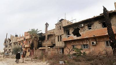 Libyans return to war-battered Benghazi