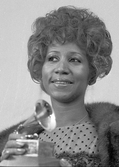 "Aretha Franklin holds her Grammy for Best Rhythm and Blue performance for the song ""Bridge Over Troubled Waters,"" on March 13, 1972, in New York."