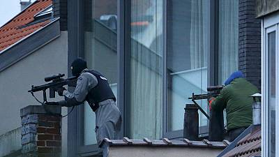Suspect gunman killed and police hurt in Brussels anti-terror raid