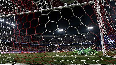 Atletico scrape through on penalties against PSV