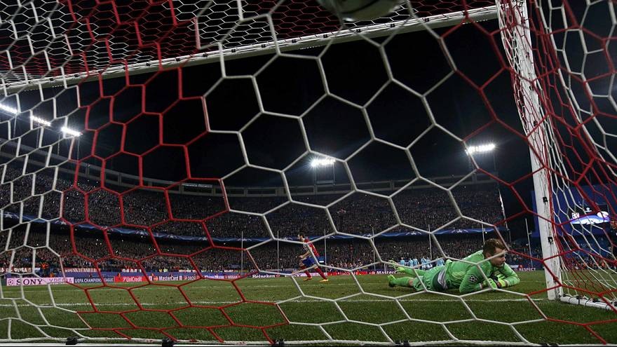 Atletico scrape through on penalties against PSV
