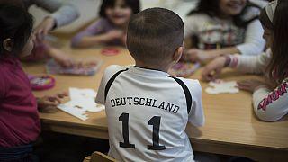Des migrants en Allemagne et de Google en Russie