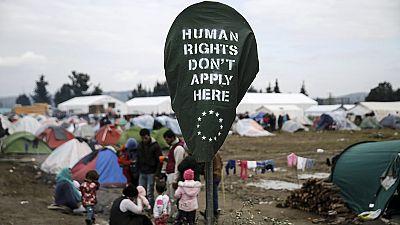 Stranded refugees struggle to keep hope alive on Greek-Macedonian border