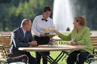 Russian President Vladimir Putin and German Chancellor Angela Merkel during their talks at the German government\'s guest house Meseberg Palace near Berlin on Saturday.