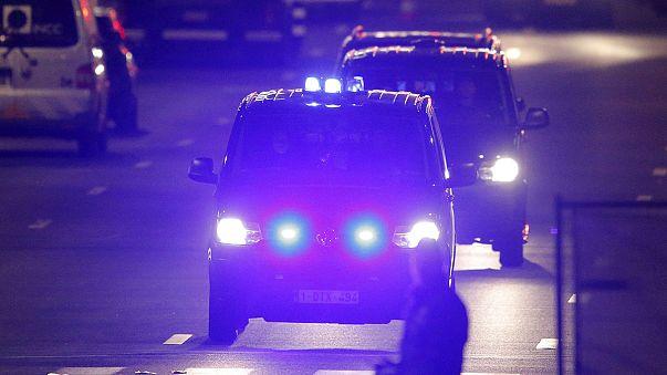 Police raids across Belgium after deadly attacks, active manhunt underway