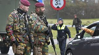 Belgium hunts bombings suspect as country mourns deadly attacks