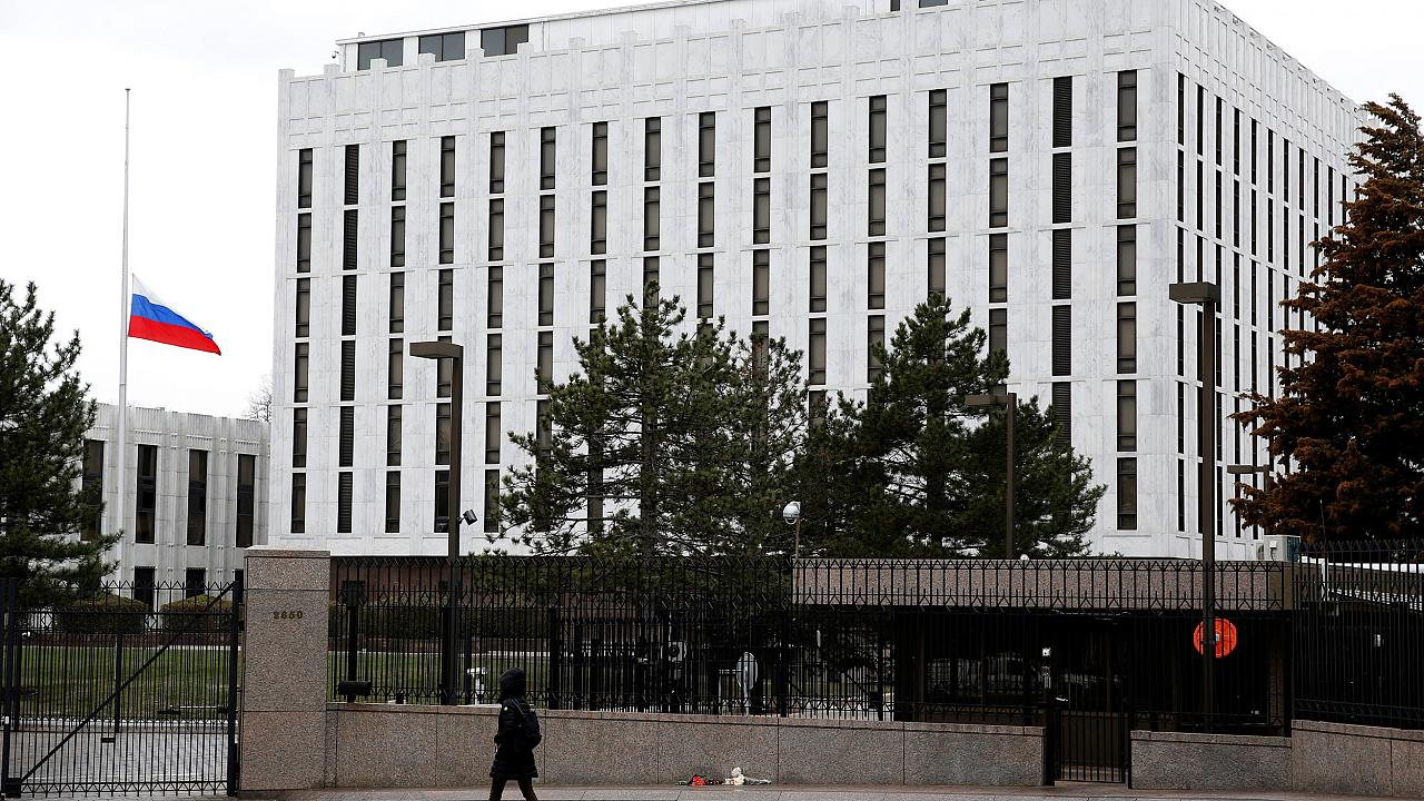 Image: A pedestrian walks past the Russian Embassy in Washington