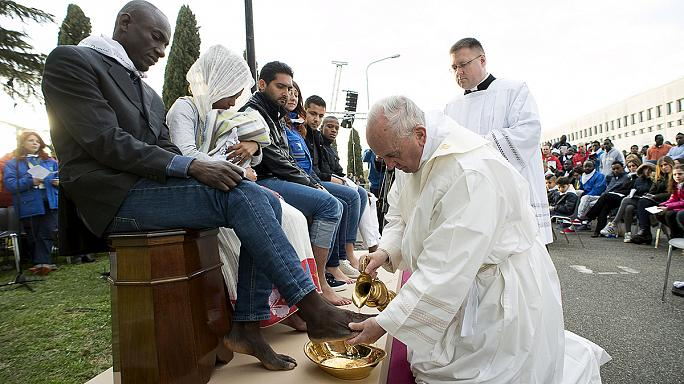 Pope Francis washes feet of refugees, condemns Brussels attacks
