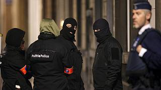 Brussels bombings: Belgian police question nine after raids