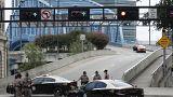 Image: Florida Highway patrolmen block the entrance to the Main Street Brid