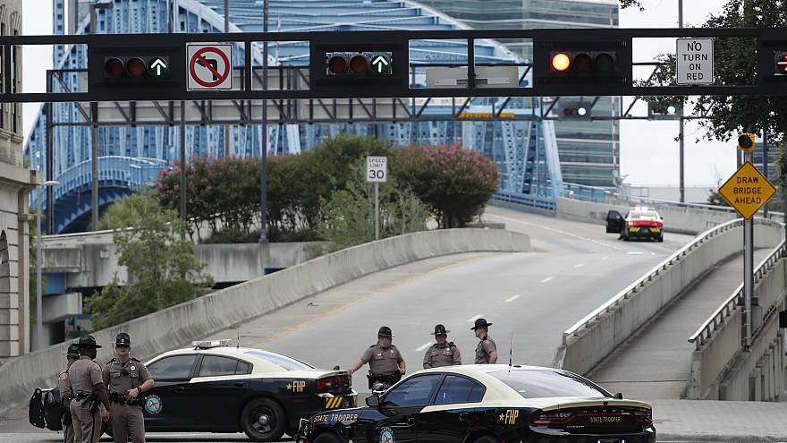 Image: Florida Highway patrolmen block the entrance to the Main Street Brid