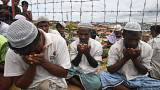 Rohingya refugees perform prayers as they attend a ceremony organised to re
