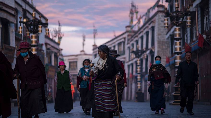 Image: Pilgrims walking and praying near the Jokhang Temple