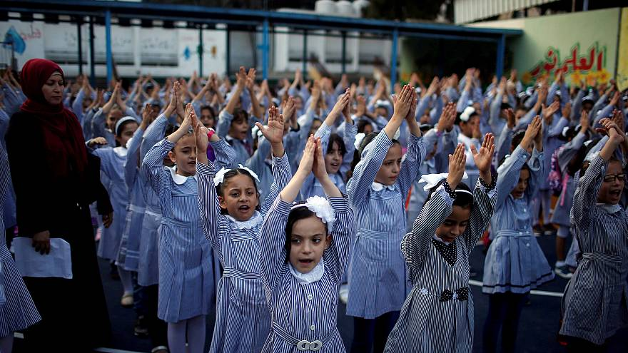 Image: Palestinian schoolgirls participate in the morning exercise at an UN