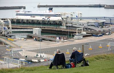The busy ferry port can be watched from Dover\'s white cliffs.