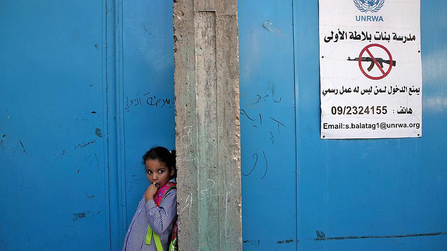 Image: A girl stands at the entrance of a school run UNRWA in the West Bank