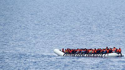 Migrants wait to be rescued in the Mediterranean Sea off the coast of Libya.