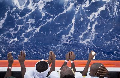 African migrants stand on the deck of the Aquarius in the Mediterranean Sea.
