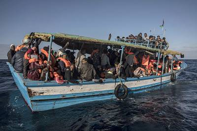 Migrants wait to be rescued off Libya\'s coast.
