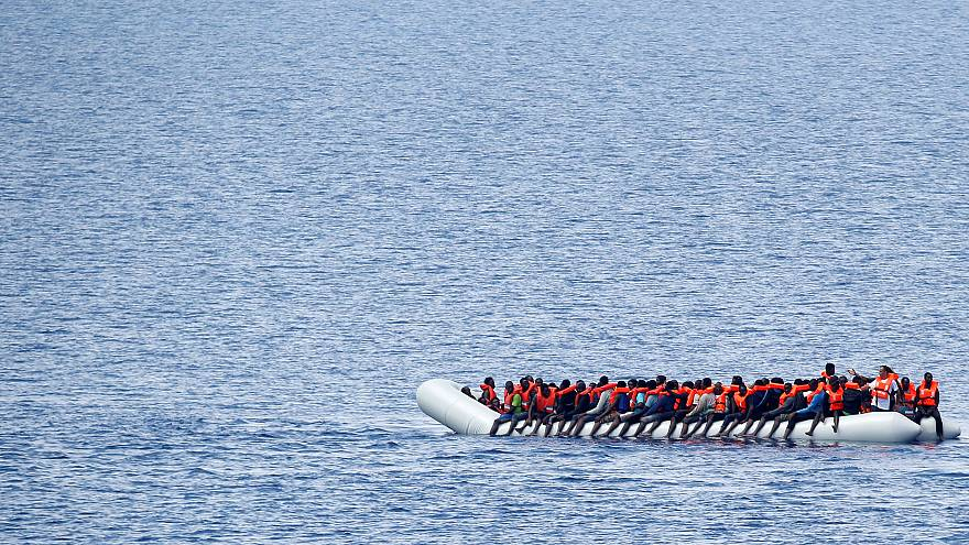 Migrants wait to be rescued in the Mediterranean Sea off the coast of Libya