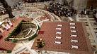 Priests prostrate themselves in St Peter's