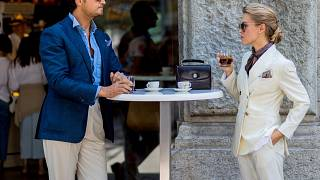 Image: A couple drink Italian coffee outside Jil Sander during the Milan Me