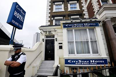A police officer stands outside the City Stay Hotel in London that was used by Alexander Petrov and Ruslan Boshirov.