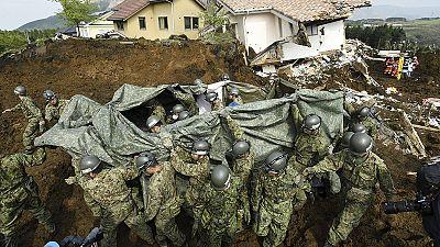Strong aftershocks strike Japan as quake survivors struggle