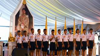 """Image:The 12 """"Wild Boars"""" at a reception in Bangkok."""