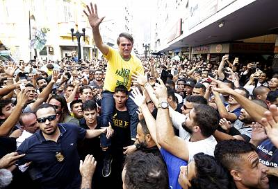 Presidential candidate Jair Bolsonaro is taken on the shoulders of a supporter moments before being stabbed during a campaign rally in Juiz de Fora, Brazil, on Sept. 6, 2018.