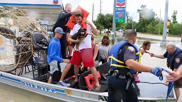 Historic floods in Houston displace hundreds
