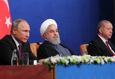 Iranian President Hassan Rouhani at a press conference with Turkish President Recep Tayyip Erodgan and Russian President Vladimir Putin in Tehran after their trilateral meeting on Friday.