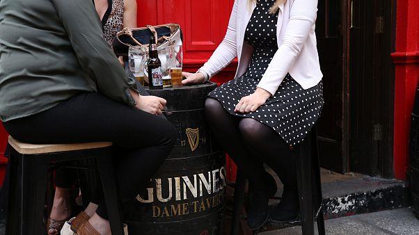 Image: A group of women enjoy a drink outside a pub in Dublin
