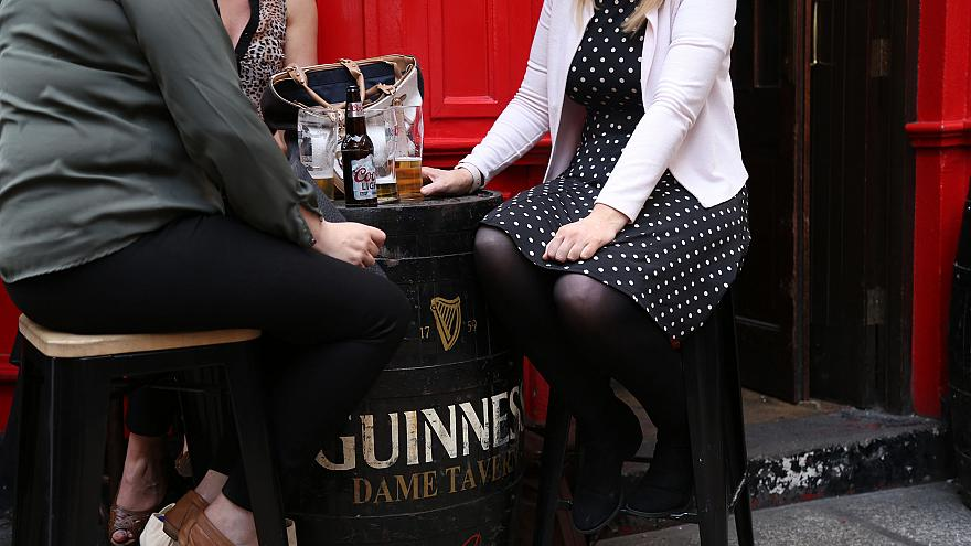 Image: A group of women enjoy a drink outside a pub in Dublin
